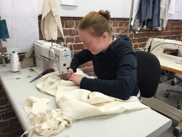 NSCAD student sews prototуpe hospital gown