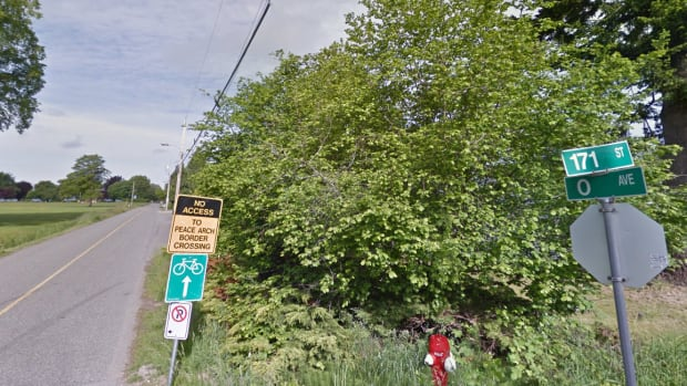 0 Avenue in Surrey, B.C. separates the United States from Canada. In some areas there is a small forest or fence dividing the countries, but in other places the neighbourhoods blend together. (Google Streetview)