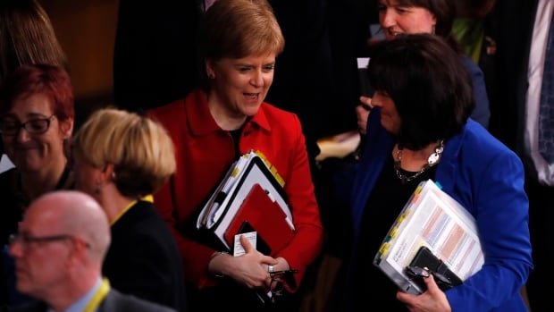 Scotland's First Minister Nicola Sturgeon leaves after the Scottish Parliament in Edinburgh voted Tuesday to proceed with a second referendum on independence.