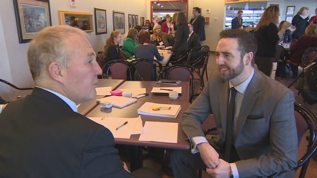 N.L. Justice Minister Andrew Parsons chats with Bill Blair, parliamentary secretary to the federal justice minister at a summit in St. John's Tuesday.