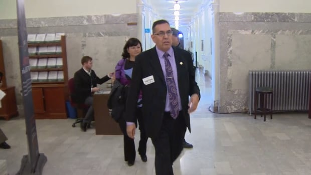 Sixties Scoop survivor Adam North Peigan leads a group of his peers into a meeting with Alberta Indigenous Relations Minister Richard Feehan Tuesday at the legislature.