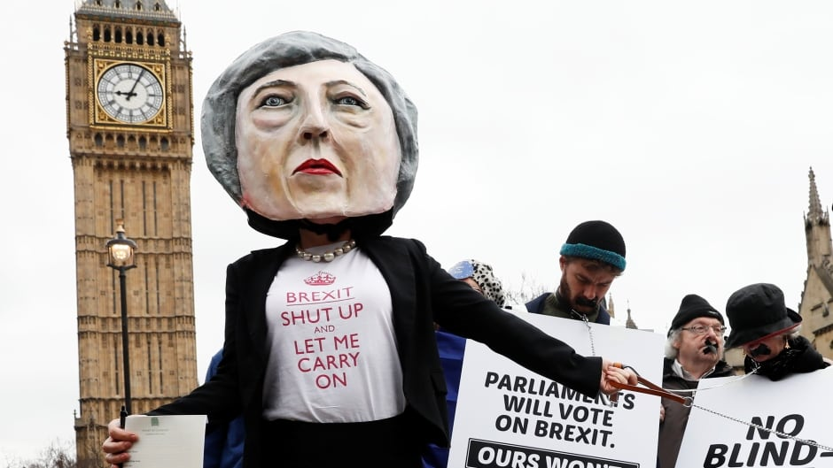Anti-Brexit protesters hold placards outside Parliament on the day Prime MInister Theresa May announced she triggered the formal process for Britain to leave the European Union. The Brexit vote, according to Marcus Pivato, has had a concrete impact on the ability of British universities to recruit and retain academics and he argues that could be to Canada's benefit.
