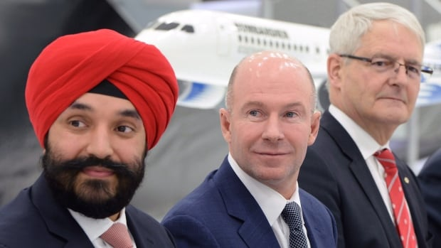Innovation Minister Navdeep Bains (left), Bombardier president and CEO Alain Bellemare (centre) and Transport Minister Marc Garneau were on hand last month to announce $372.5 million in federal loans for the Global 7000 and CSeries aircraft projects.
