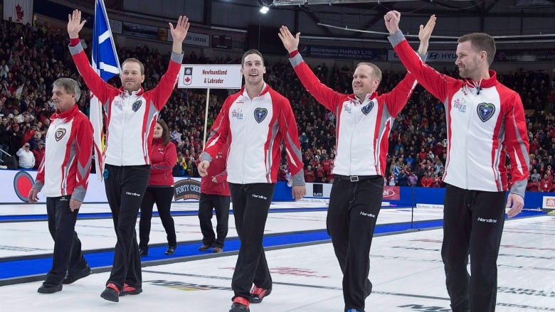 Brett Gallant Geoff Walker And Coach Jules Owchar Right To Left Head Down The Rink After Winning Tim Hortons Brier Curling Championship In St