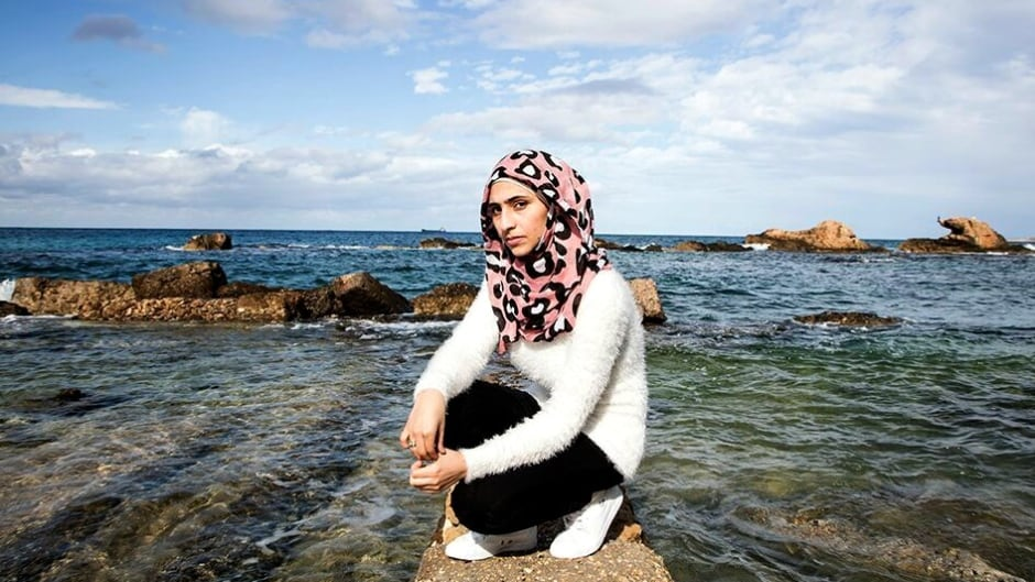 Doaa Al Zamel survived four days floating in the Mediterranean sea  with the children of strangers in her arms, after the boat she was on sank.