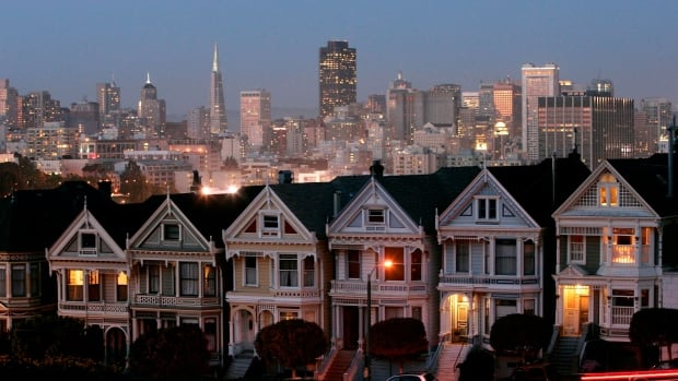 "The ""Painted Ladies,"" a row of historical Victorian homes, underscore the San Francisco skyline. A renters' advocate says NIMBY voices blocking higher-density housing is part of why that city's market is so unaffordable."