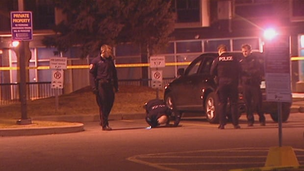 Ottawa police analyze the scene of a shooting on Kilborn Place near Riverside Drive and Bank Street early Friday morning.