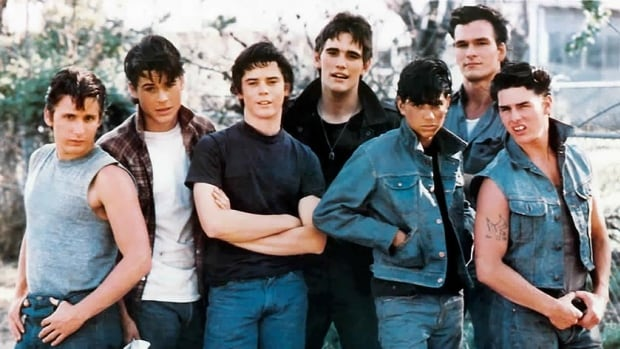 The book inspired a successful 1983 film adaptation directed by Francis Ford Coppola. It starred from left to right: Emilio Estevez, Rob Lowe, C. Thomas Howell, Matt Dillon, Ralph Macchio, Patrick Swayze, and Tom Cruise.