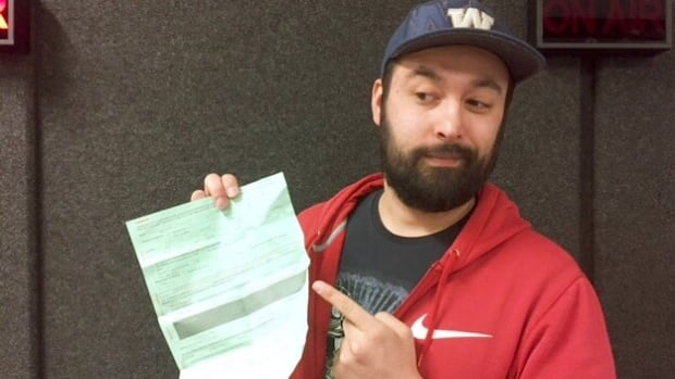 Kevin Kaufmann points to his traffic ticket with a different finger than the one he says police allege he was using.