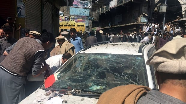 Residents gather at the site of a powerful explosion near Noor Market in Parachinar, located in northwest Pakistan, on Friday. Jamaat-ul-Ahrar, a breakaway faction of Pakistani Taliban militants, claimed responsibility.