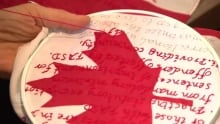 Winnipeg artist sews TRC's 94 calls to action into Canadian flags