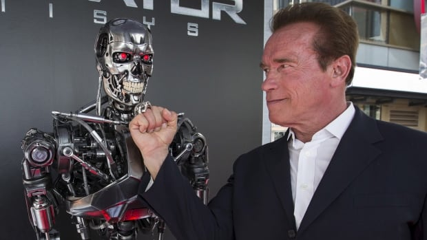 Arnold Schwarzenegger hams it up with his alter ego the Terminator. Experts say the danger is not that AI is too strong, but that we will trust it when it is too weak.