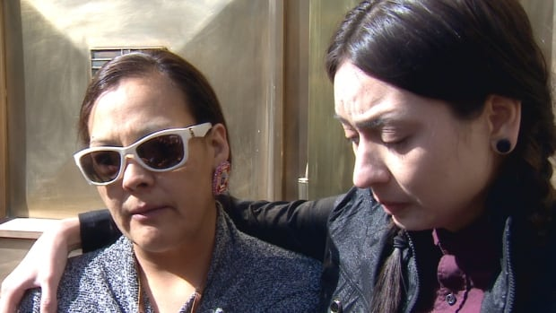 Stephanie English, the mother of Joey English, is supported by family member Brailon after a judge warned them not to expect a lengthy sentence for the man who dismembered and disposed of Joey's body.