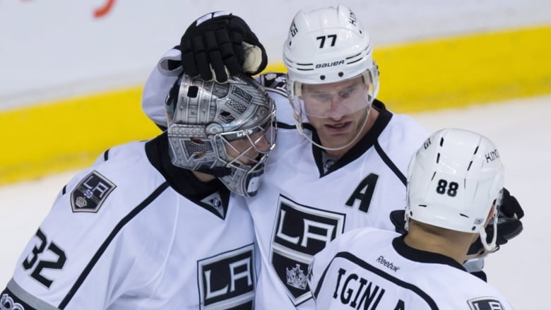 b69110472 Jonathan Quick, left, Jonathan Quick made 35 saves to lead the Los Angeles  Kings past the Vancouver Canucks on Friday evening. (Darryl Dyck/The  Canadian ...
