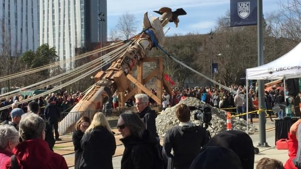 A 17-metre tall totem pole, carved from an 800-year-old cedar tree was raised at UBC on Saturday April 1, 2017 and represents the victims and survivors of Canada's residential school system.