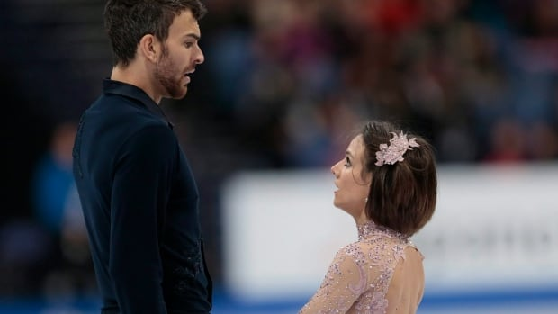 Meagan Duhamel and Eric Radford react after skating their free program at the world figure skating championships in Helsinki, Finland, on Thursday.