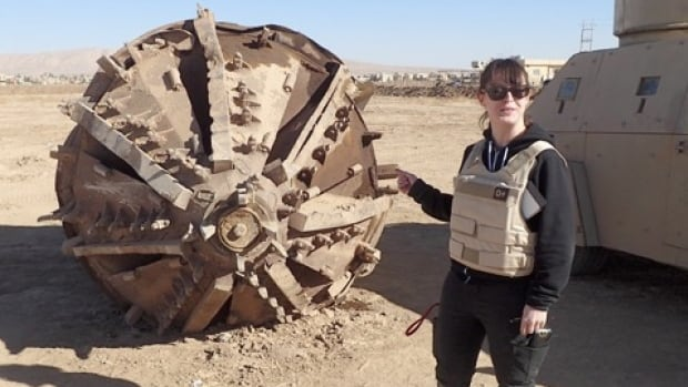 Devin Morrow, a 30-year-old Winnipegger living in northern Iraq, is a technical advisor with U.K.-based Conflict Armament Research, a company that tracks and documents illegally diverted weapons in conflict zones. She's shown with an ISIS tunnel-boring machine in Hamdaniyah.