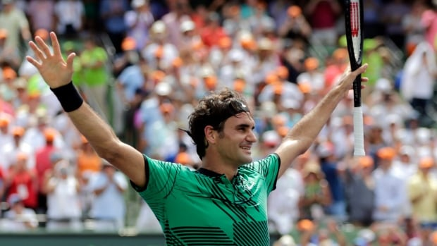 Roger Federer celebrates after defeating Rafael Nadal in the men's singles final at the Miami Open on Sunday in Key Biscayne, Fla.
