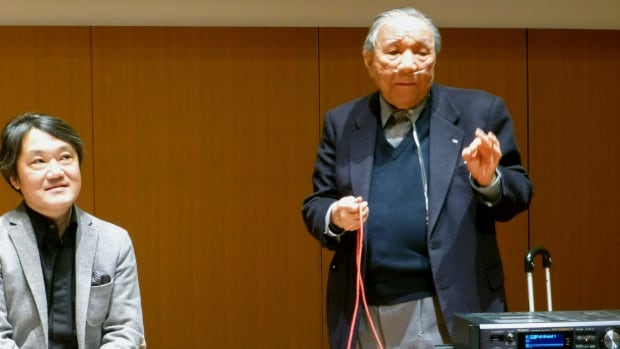 Ikutaro Kakehashi, right, speaks in Japan during a press conference after he received a Grammy, for developing MIDI technology, or Musical Instrumental Digital Interface, which digitally connects instruments.