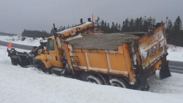 TCH plow stuck in snow median highway Newfoundland spring blizzard