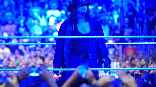 Pro wrestler The Undertaker signals retirement at ...