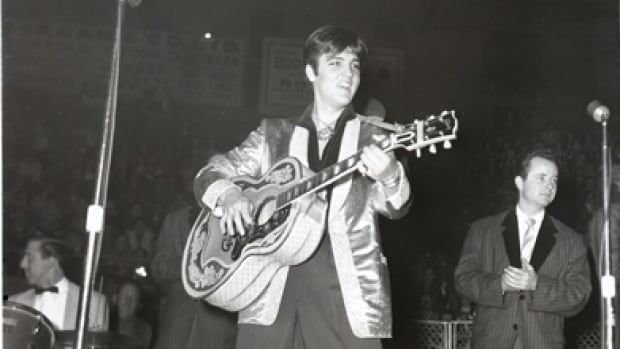 Elvis Presley performs at the Ottawa Auditorium on April 3, 1957.