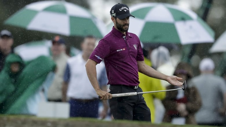 5e2be4a9736 Masters rookie Adam Hadwin lined up a putt during Monday s practice round  at Augusta