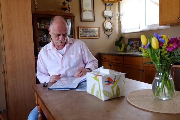 John MacTavish with photos and urn