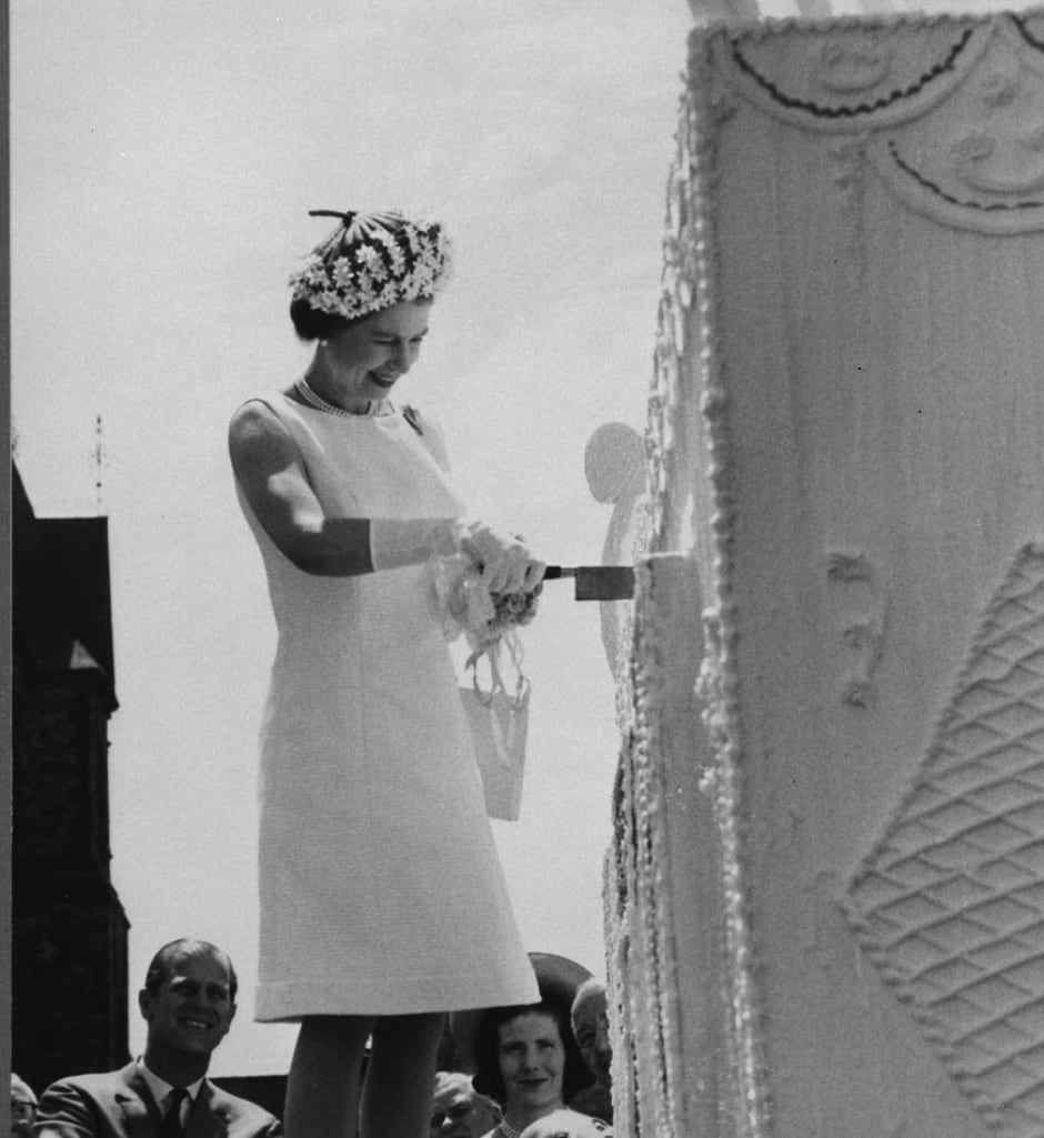 Queen Elizabeth cuts Centennial birthday cake on Parliament Hill July 1, 1967