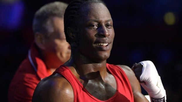 Canada's Custio Clayton enters the ring before fighting Australia's Cameron Hammond in a men's welterweight 69-kg preliminary boxing match at the 2012 Summer Olympics.