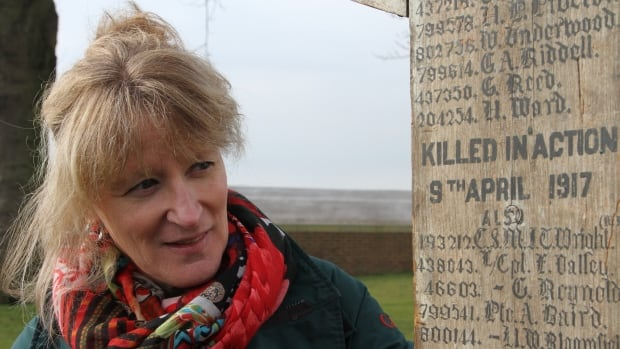 Johanne Gagne from Veterans Affairs Canada helped bring the cross to Nine Elms Military Cemetery, seven kilometres south of Vimy, France, where the men named on it are buried — the first time the cross has been reunited with the men whose names it has carried for 100 years.