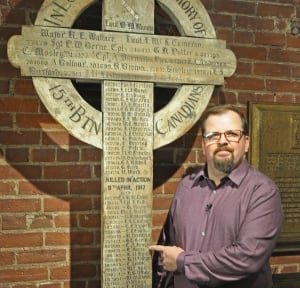 Scott Keen points to 15th Battalion Vimy cross