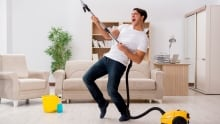 519407452 man happy to be vacuuming