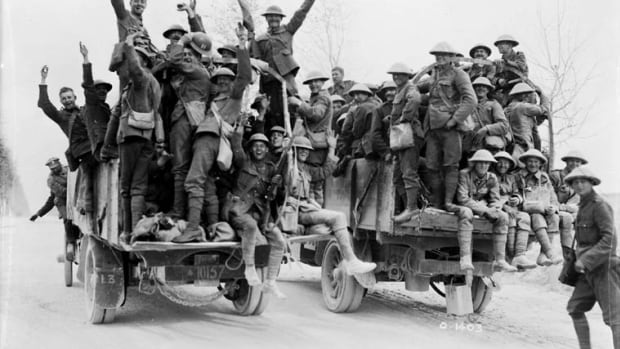 Canadian soldiers celebrate in the wake of their successful attack on Vimy Ridge.