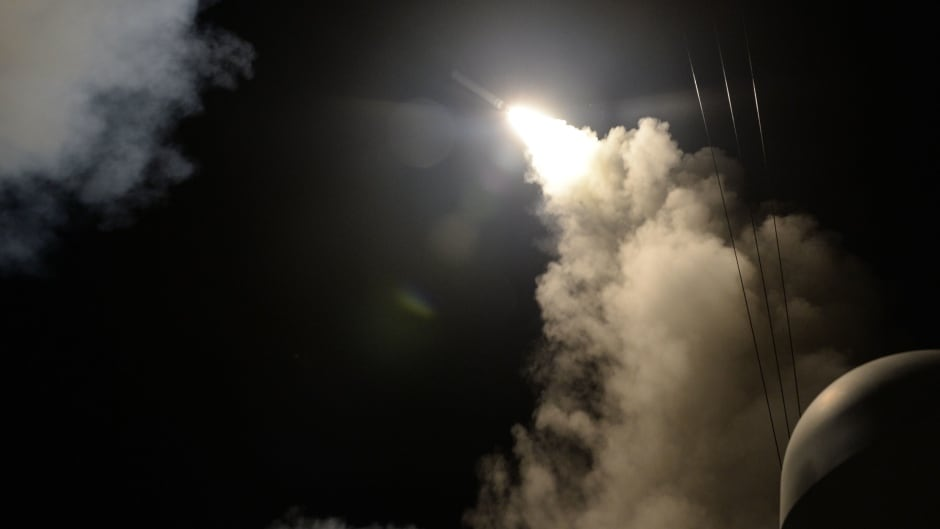 A handout photo made available by the US Navy Office of Information shows the guided-missile destroyer USS Porter (DDG 78) launching a missile strike while in the Mediterranean Sea, April 7, 2017. The United States military launched at least 50 tomahawk cruise missiles against al-Shayrat military airfield near Homs, Syria, in response to the Syrian military's alleged use of chemical weapons in an airstrike in a rebel held area in Idlib province on April 4, 2017.