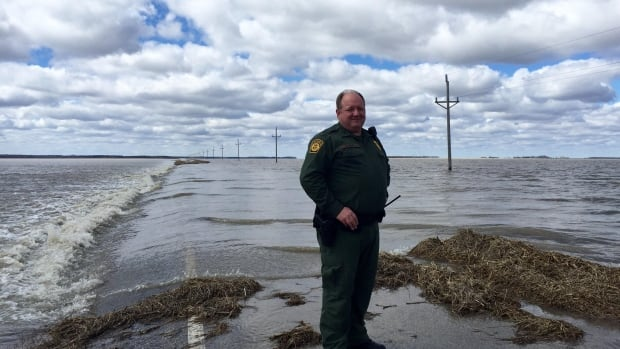 Eric Kuhn, U.S. Border Patrol agent, says spring flooding of the Red River and its tributaries is pushing some asylum seekers further East as they look for places to cross the border on foot.