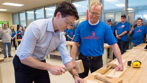 Prime Minister Justin Trudeau displays his woodworking skills during a visit to the Nova Scotia Community College in Dartmouth, N.S., on Friday.