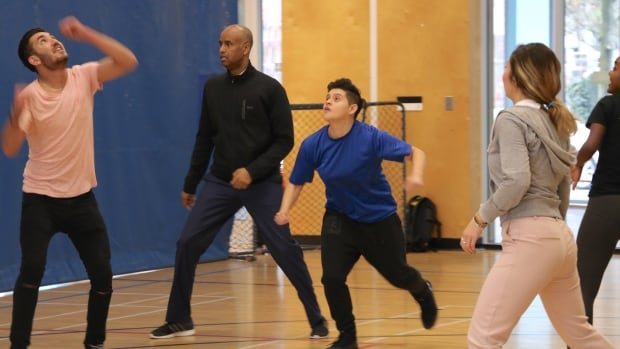Immigration Minister Ahmed Hussen (second from left) played soccer with a group of immigrant and refugee teens in Vancouver on Friday after a meeting about government services.