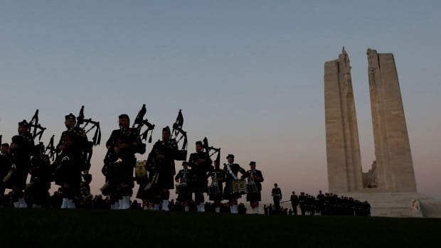 Canadian soldiers leave after the sunset ceremony April 8 at Vimy Canadian National Memorial, on the eve of the ceremony to commemorate the 100th anniversary of the Battle of Vimy Ridge.