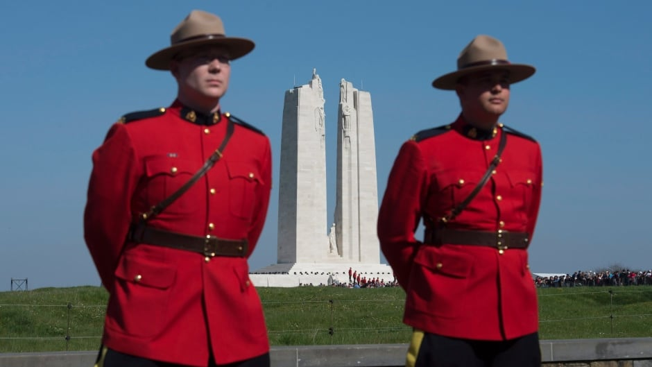 RCMP officers stand at the entrance to the National Vimy Memorial in France before ceremonies to mark the 100th anniversary of the battle on Sunday.