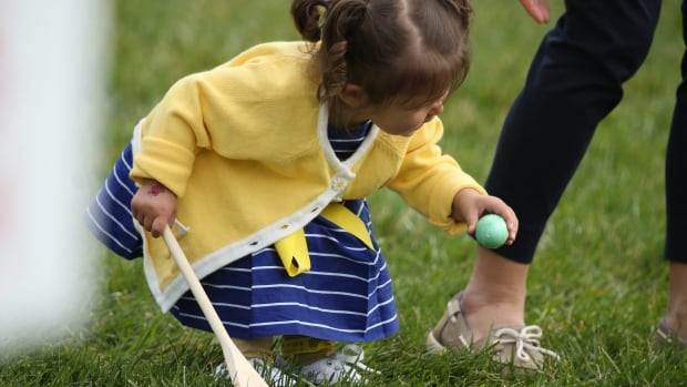 A child participates in an Easter egg roll.