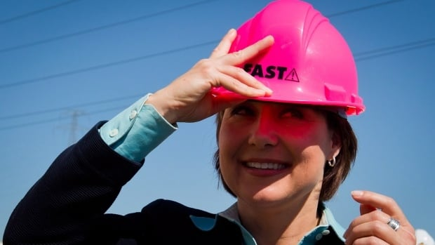 B.C. Premier and Liberal Leader Christy Clark puts on a pink hard hat during the 2013 provincial election campaign.