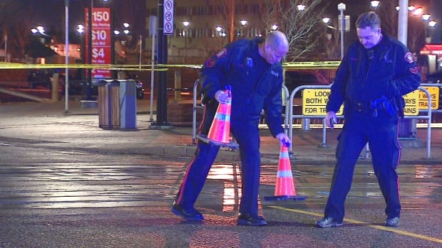 Officers place evidence markers over what appear to be shell casings after a shooting in the East Village on Tuesday.