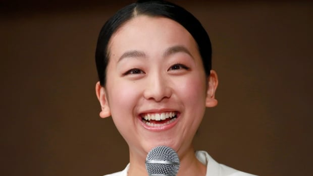 Japan figure skating idol Mao Asada speaks during a press conference at a hotel in Tokyo on Wednesday, two days after announcing her retirement on her blog.