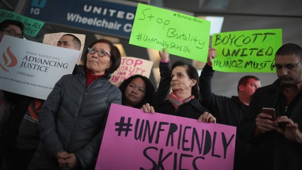 Demonstrators protest outside the United Airlines terminal at O'Hare International Airport on April 11 after a cellphone video was released showing a passenger being dragged from his seat by airport police. Jo Davies says that incident, and United's initial response, was a massive customer service blunder, but not a rare case.