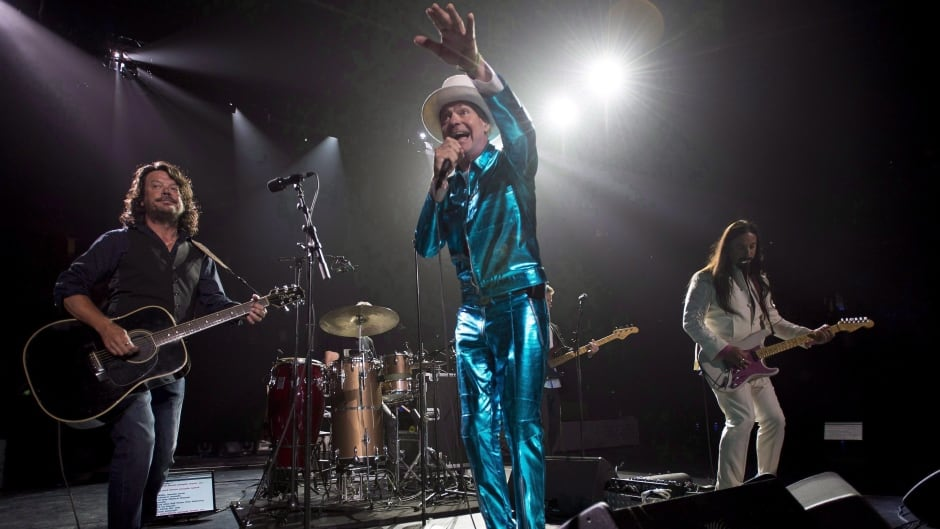 Tragically Hip frontman Gord Downie, centre, leads the band through a concert in Vancouver, Sunday, July 24, 2016. Downie has been voted The Canadian Press Newsmaker of the Year for 2016. THE CANADIAN PRESS/Jonathan Hayward