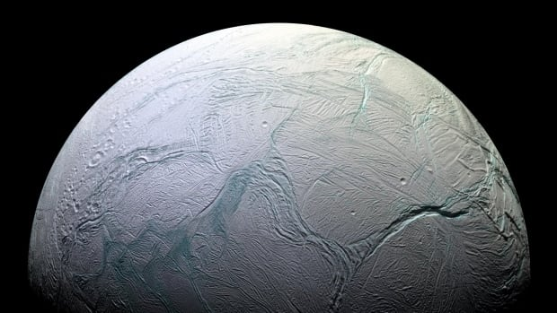 "This enhanced-colour Cassini view of Enceladus features the bluish ""tiger stripe"" fractures on the small moon."