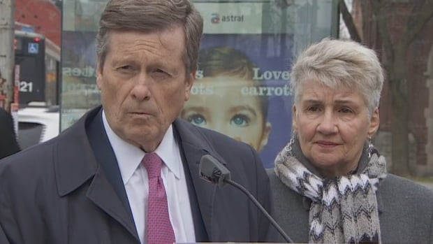 Toronto Mayor John Tory appeared with Coun. Paula Fletcher at the corner of Queen Street East and Carlaw Avenue Wednesday. The mayor called on the provincial government to join with the city and federal government to commit money for a relief subway line into Toronto's downtown core.