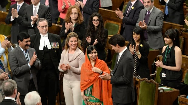 Pakistani activist Malala Yousafzai, centre, spoke to the House of Commons on Parliament Hill in Ottawa on Wednesday. She is the youngest person to address Canada's Parliament.