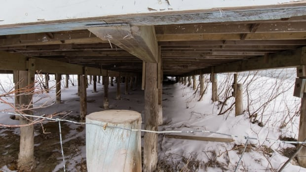 A building now set to be torn down in Inuvik, N.W.T. Some of the piles that support it have sunk and others have heaved up, leaving the building dangerously unstable. Thawing permafrost causes approximately $51 million in damage to public infrastructure every year in the Northwest Territories, according to a new study.